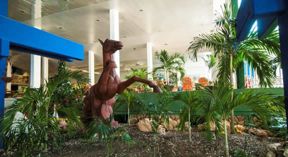 horse sculpture in the lobby surrounded by plants