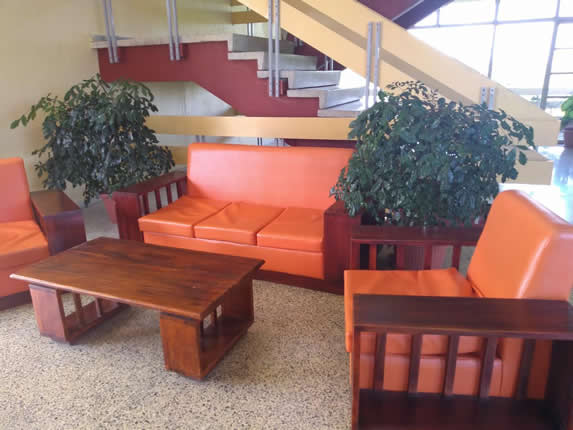 wooden furniture with plants in the lobby