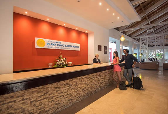reception desk with hotel sign