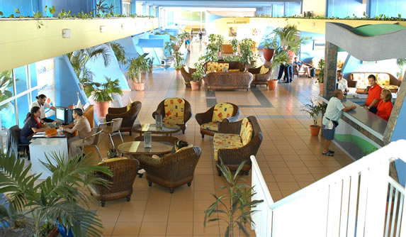 lobby with wicker furniture and reception desk