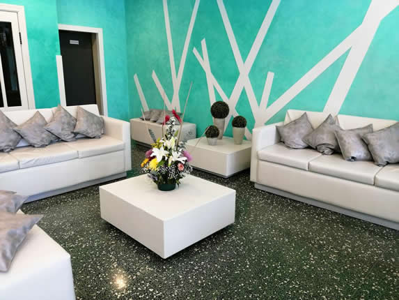 hotel reception with white furniture