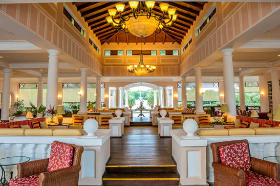 lobby with wooden ceiling and furniture