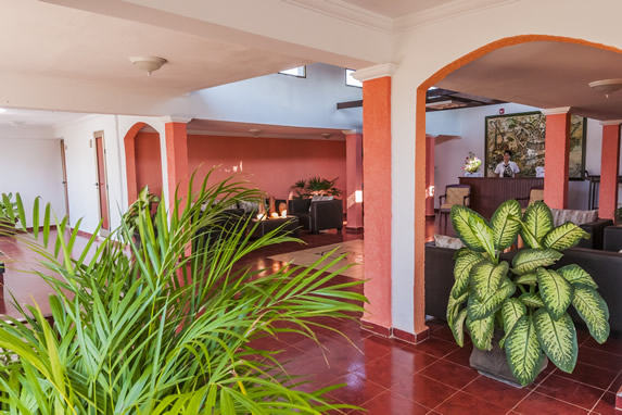 lobby with furniture and decorative plants