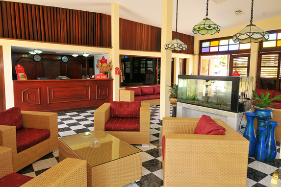 lobby with wicker furniture and colorful window