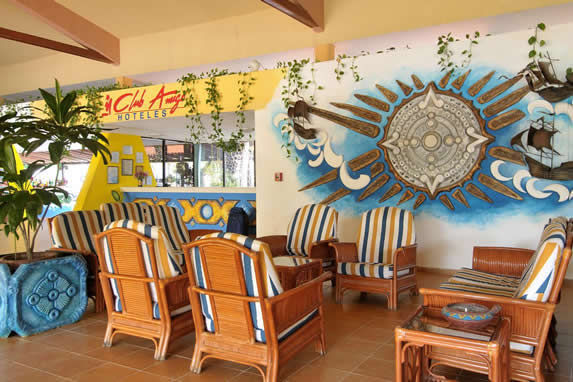 Lobby decorated with colorful mural and furniture