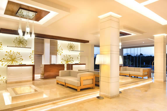 lobby with wooden reception and furniture