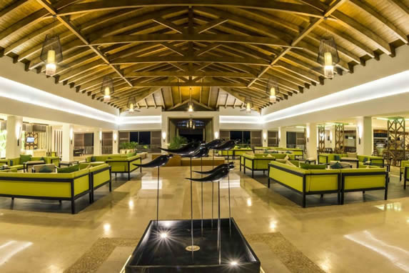 lobby with wooden ceiling and green furniture