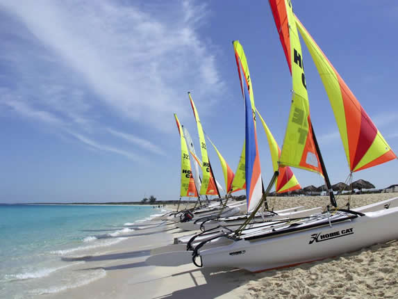 beach with catamarans and blue sky