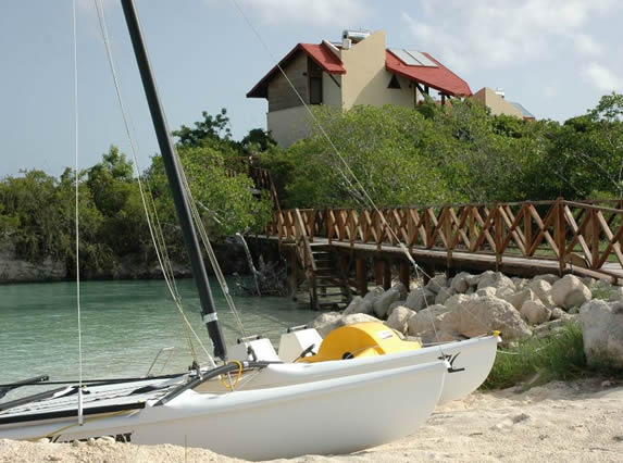 white sand beach and catamaran