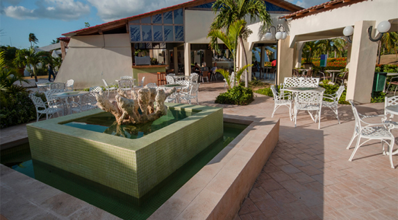 fountain in the patio with iron furniture