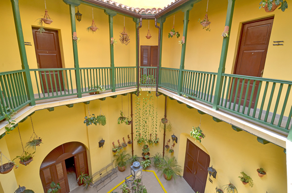 interior patio with greenery and balconies