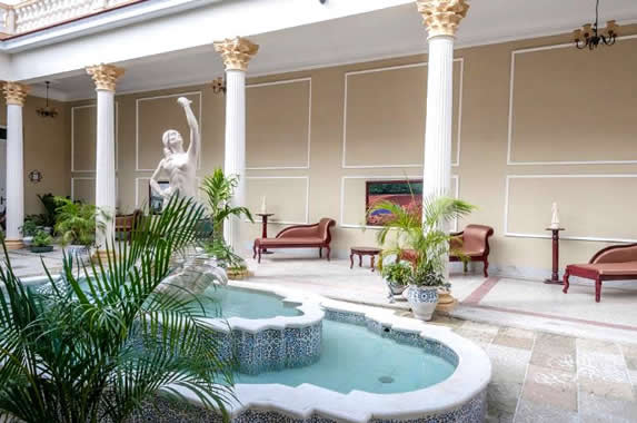 interior patio with antique furniture and fountain