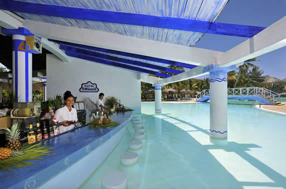 wooden roofed bar inside the pool