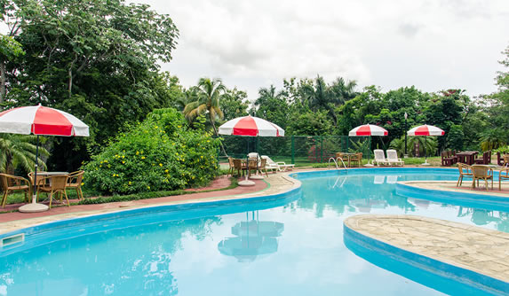 pool with umbrellas and furniture around