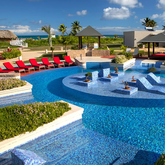 pool with red loungers around