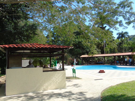 pool with snack bar and trees around