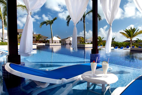 pool with palm trees and loungers around