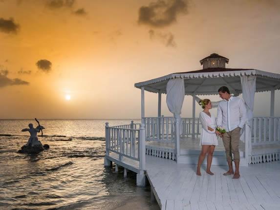 white wooden pergola on the beach for weddings