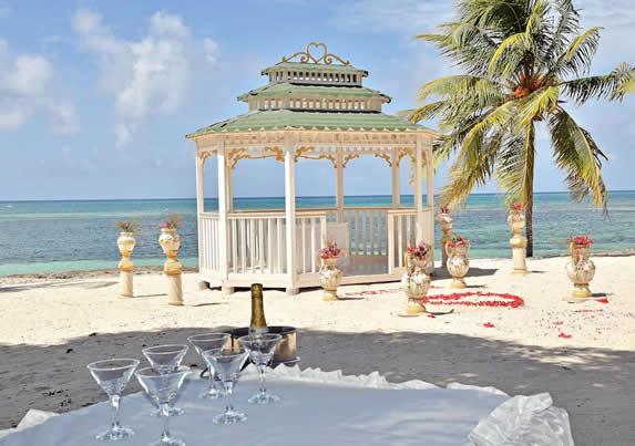 beach with pergola and wedding decoration