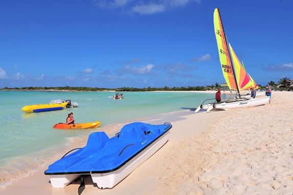 water bikes and kayaks on the beach