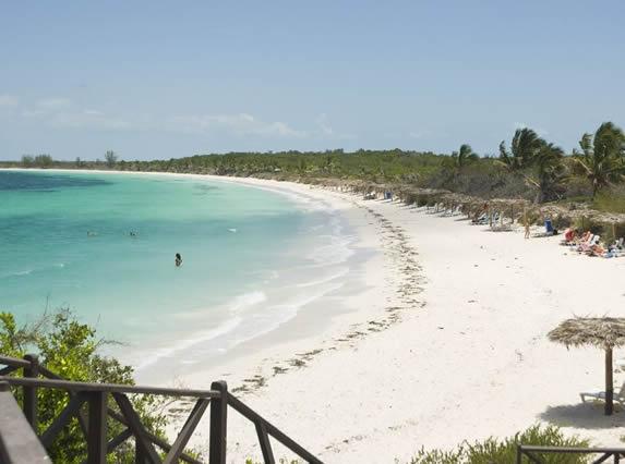 beach with guano umbrellas and blue sea