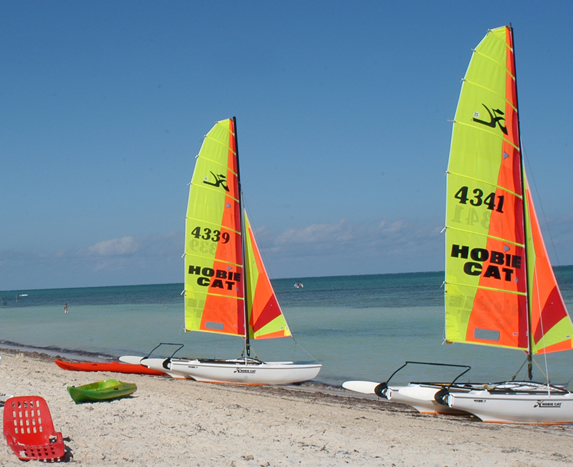 colorful sailboats on the beach