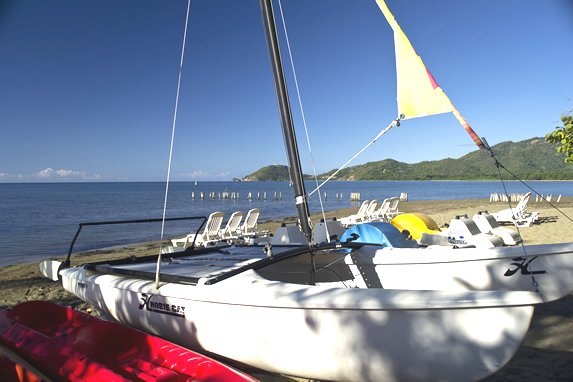 catamaran on the beach with mountains in the back