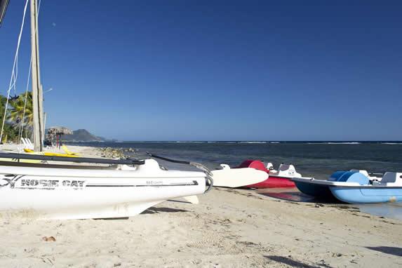 catamaran and water bikes on the beach