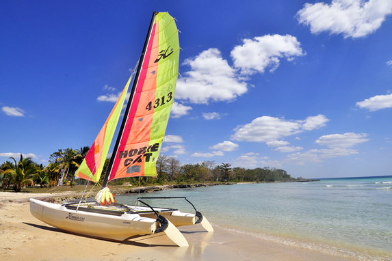 hotel beach with sail boat on the shore