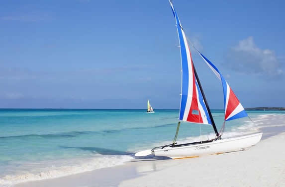 crystal clear beach and catamaran on the shore