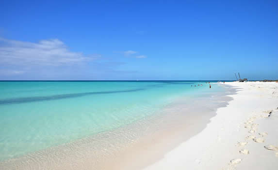crystal clear water beach and golden sands