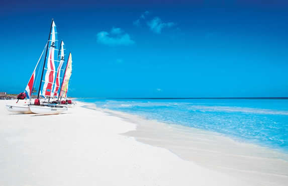beach with colorful catamarans on the shore