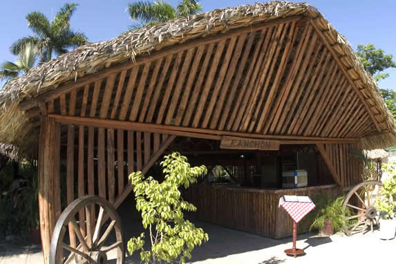 wood restaurant exterior and guano roof
