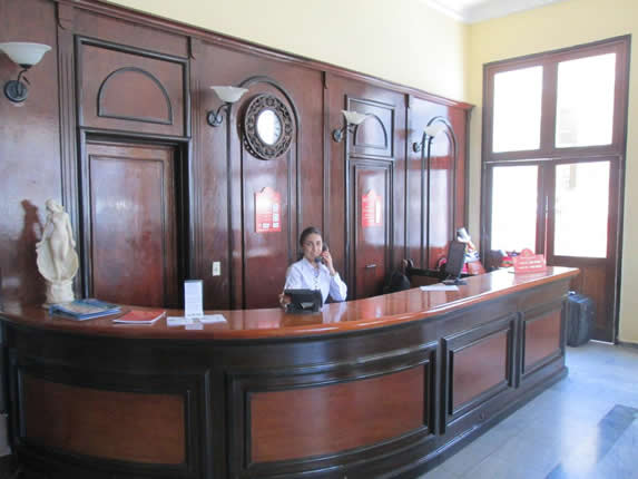 wooden reception desk and receptionist