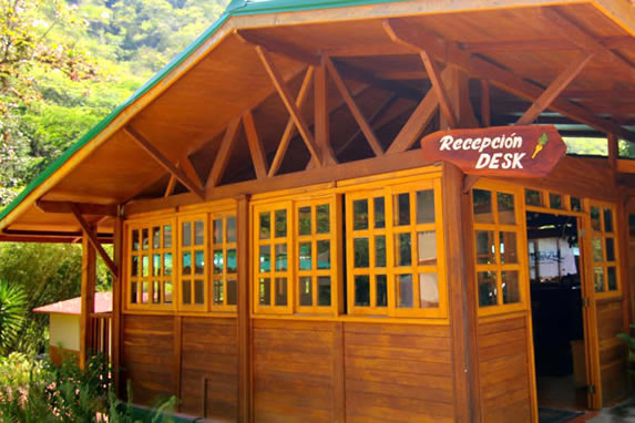 wooden house with reception desk sign