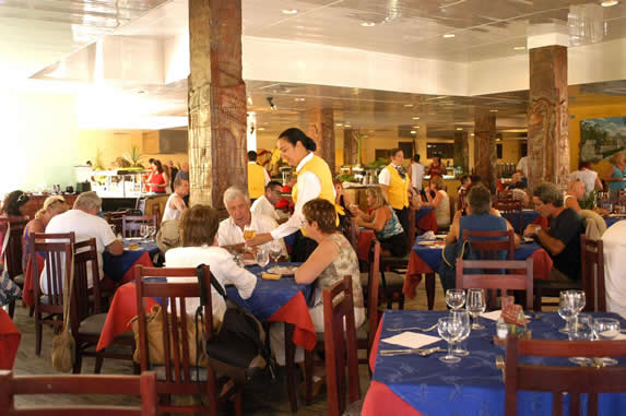 tourists in restaurant with wooden furniture