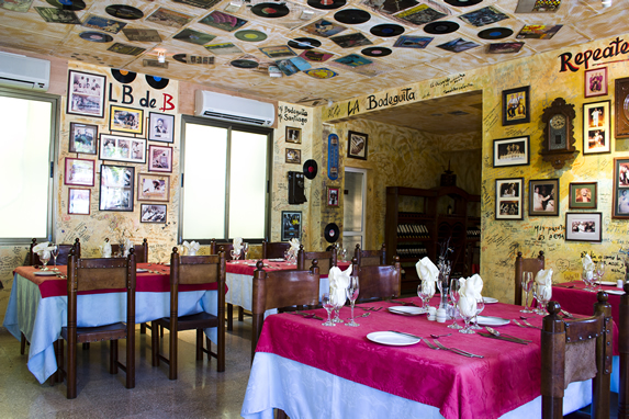 restaurant decorated with old records and photos