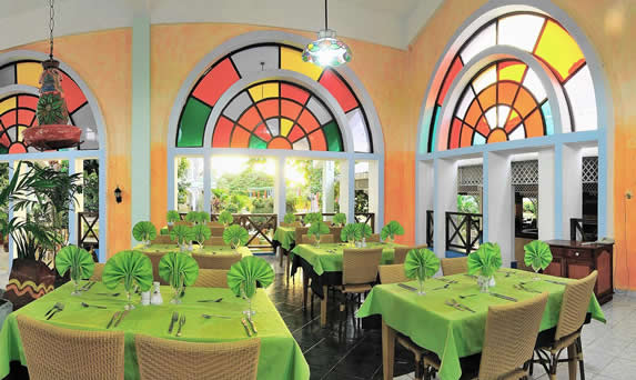 restaurant decorated with colorful stained glass