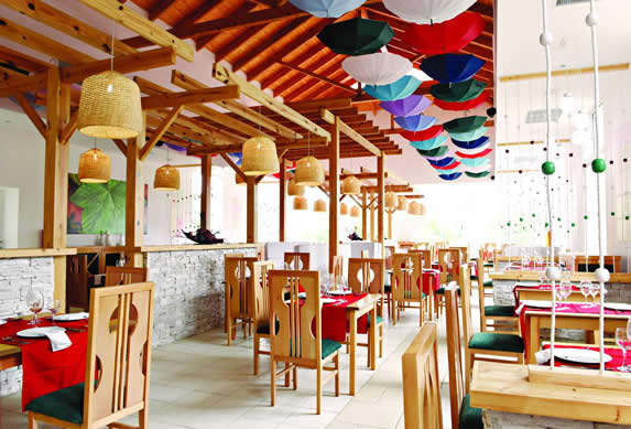 restaurant with wooden furniture and table linen