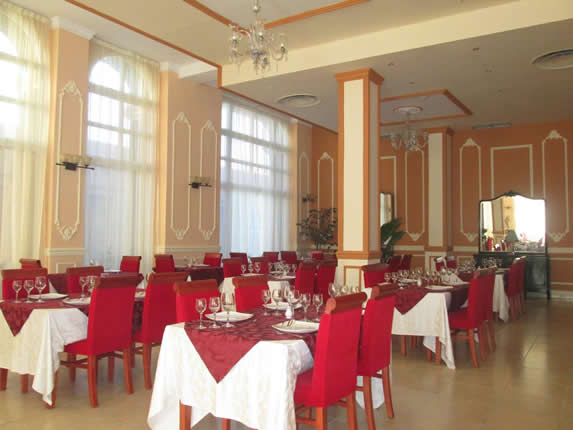 restaurant with furniture and linens