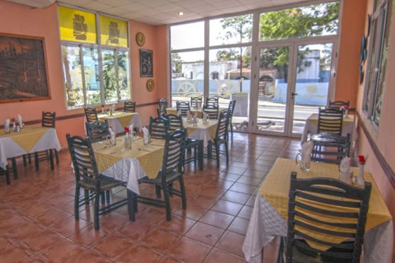 restaurant with furniture and decorative paintings