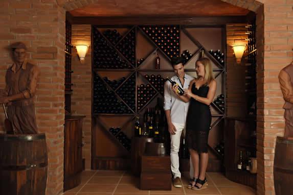tourists in the restaurant wine cellar