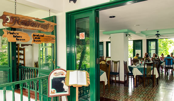 restaurant with green windows and furniture