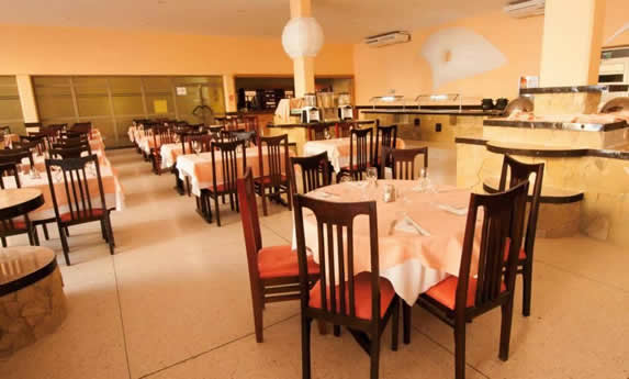 restaurant with wooden furniture and tablecloths