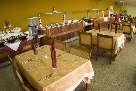 buffet restaurant with furniture and tablecloths