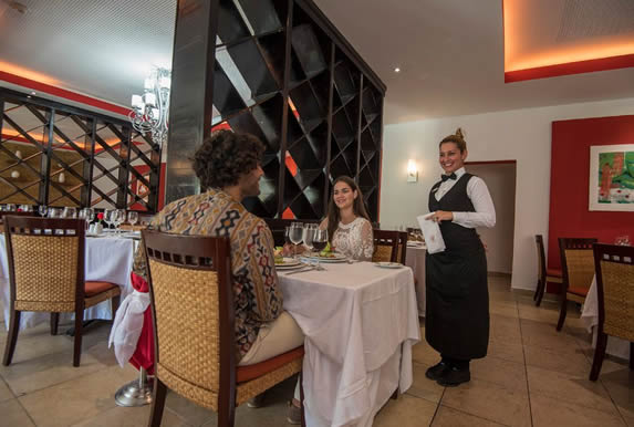 elegant restaurant with table linen and furniture