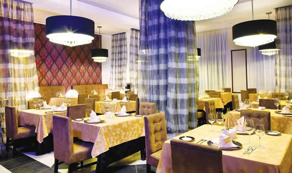 elegant restaurant with furniture and linens