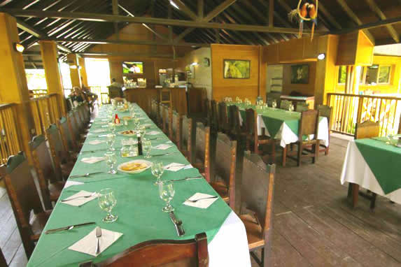 restaurant with wooden ceiling and rustic tables