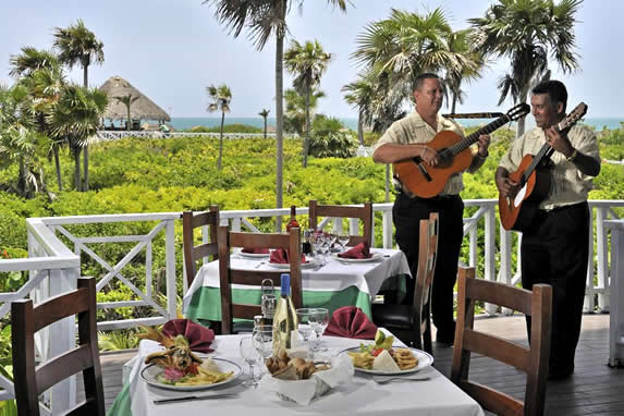 open-air restaurant with musicians playing