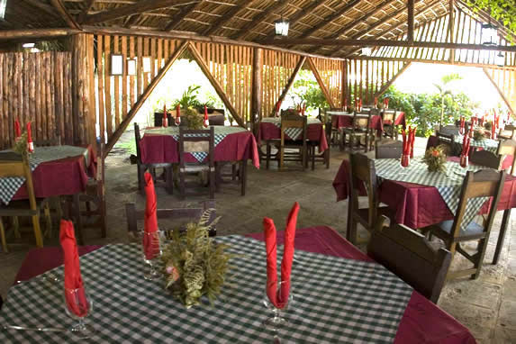 wood restaurant with guano roof